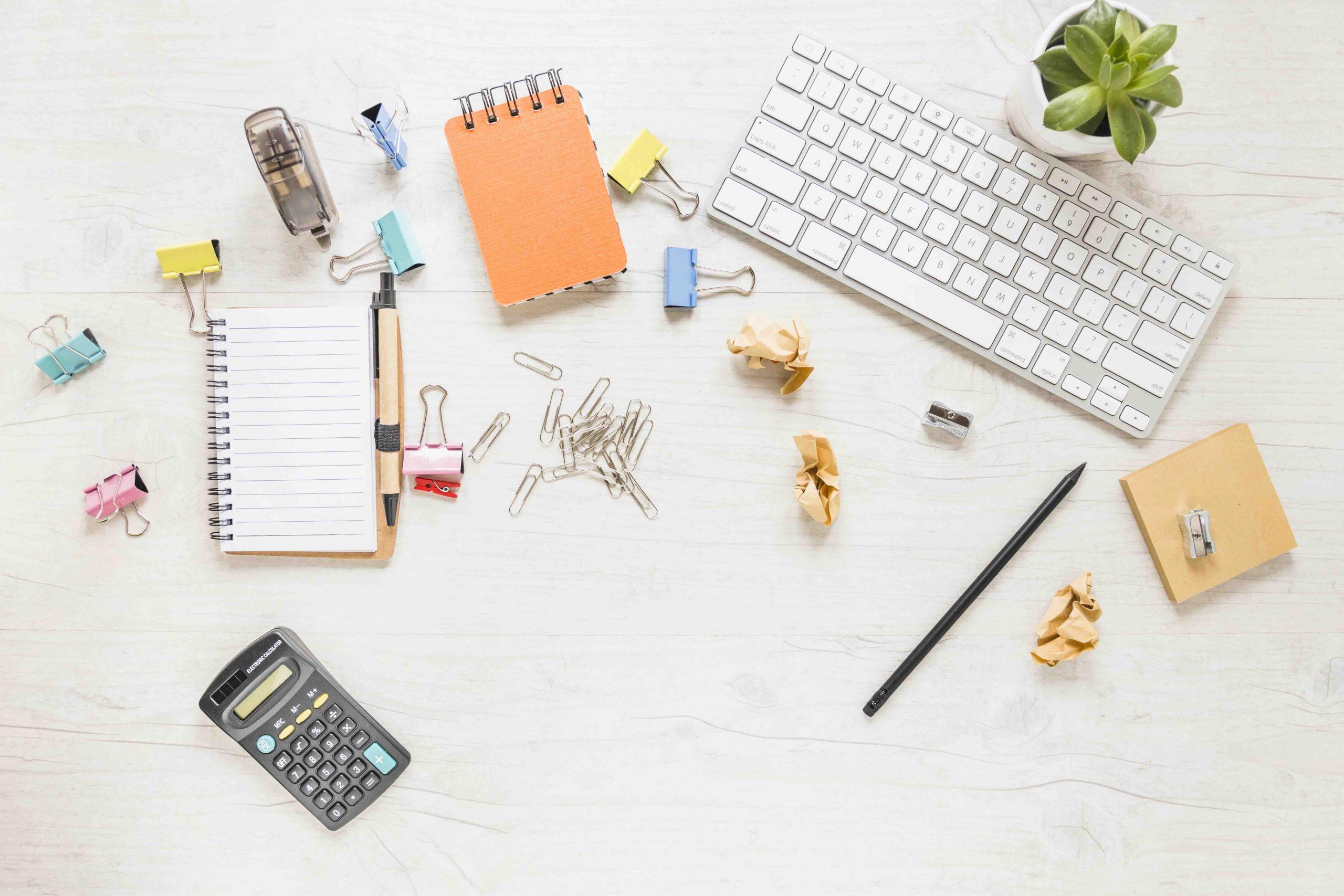 Desktop with keyboard, Paperclips, calculator